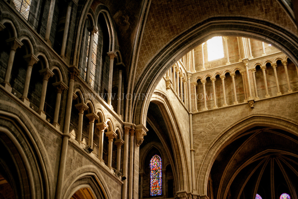 The arch, stained glass, and vaulted ceiling in the Cathedral of Notre Dame of Lausanne, Switzerland (Horizontal)