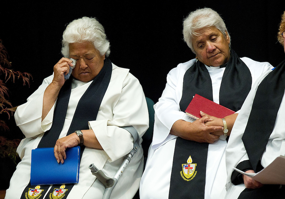 Archdeacon Hariata Tahana (L) sheds a tear with Reverend Mihi Namana as the names of those lost were read out during the Carterton Civic Service for those lost in the hot air ballooning tragedy at the Carterton Event Center, Carterton, New Zealand, Sunday, March 04, 2012. Credit: SNPA / Marty Melville