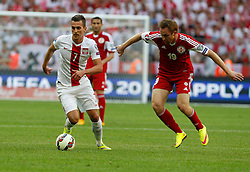 13.06.2015, Nationalstadion, Warschau, POL, UEFA Euro 2016 Qualifikation, Polen vs Greorgien, Gruppe D, im Bild ARKADIUSZ MILIK POL ALEKSANDRE KOBACHIDZE GEO // during the UEFA EURO 2016 qualifier group D match between Poland and Greorgia at the Nationalstadion in Warschau, Poland on 2015/06/13. EXPA Pictures © 2015, PhotoCredit: EXPA/ Pixsell/ MICHAL CHWIEDUK<br /> <br /> *****ATTENTION - for AUT, SLO, SUI, SWE, ITA, FRA only*****