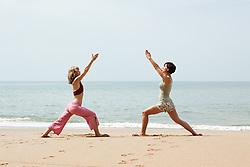 Jul. 25, 2012 - Two women practicing yoga on a beach (Credit Image: © Image Source/ZUMAPRESS.com)