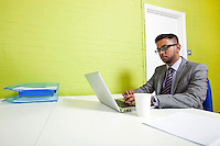 Indian businessman working at his desk
