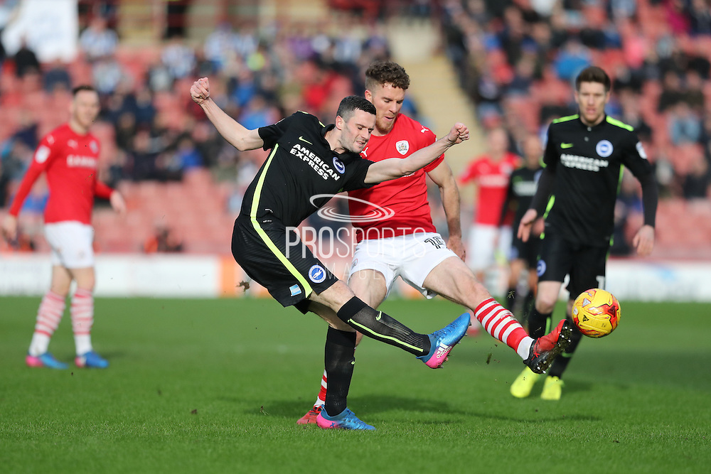 Brighton & Hove Albion winger Jamie Murphy (15) and Barnsley midfielder Marley Watkins (15) during the EFL Sky Bet Championship match between Barnsley and Brighton and Hove Albion at Oakwell, Barnsley, England on 18 February 2017.