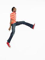 Man jumping in studio