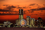 A ferris wheel stands at the center of the Minato Mirai business and shopping center in Yokohama, Japan.