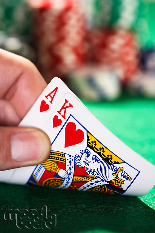 Man peeked at two cards close up of hand
