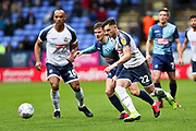Bolton Wanderers midfielder Dennis Politic tackled by the opponent during the EFL Sky Bet League 1 match between Bolton Wanderers and Wycombe Wanderers at the University of  Bolton Stadium, Bolton, England on 15 February 2020.