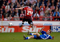 Photo: Glyn Thomas.<br />Sheffield Utd v Cardiff City. Coca Cola Championship.<br />29/10/2005.<br />Cardiff's Rhys Weston (R) slides in but David Weston leaps over the tackle.