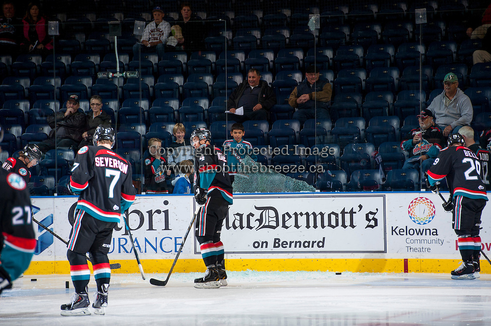 KELOWNA, CANADA - OCTOBER 19: The Kelowna Rockets gather glass after breaking a panel during warm up on October 19, 2013 at Prospera Place in Kelowna, British Columbia, Canada.   (Photo by Marissa Baecker/Shoot the Breeze)  ***  Local Caption  ***