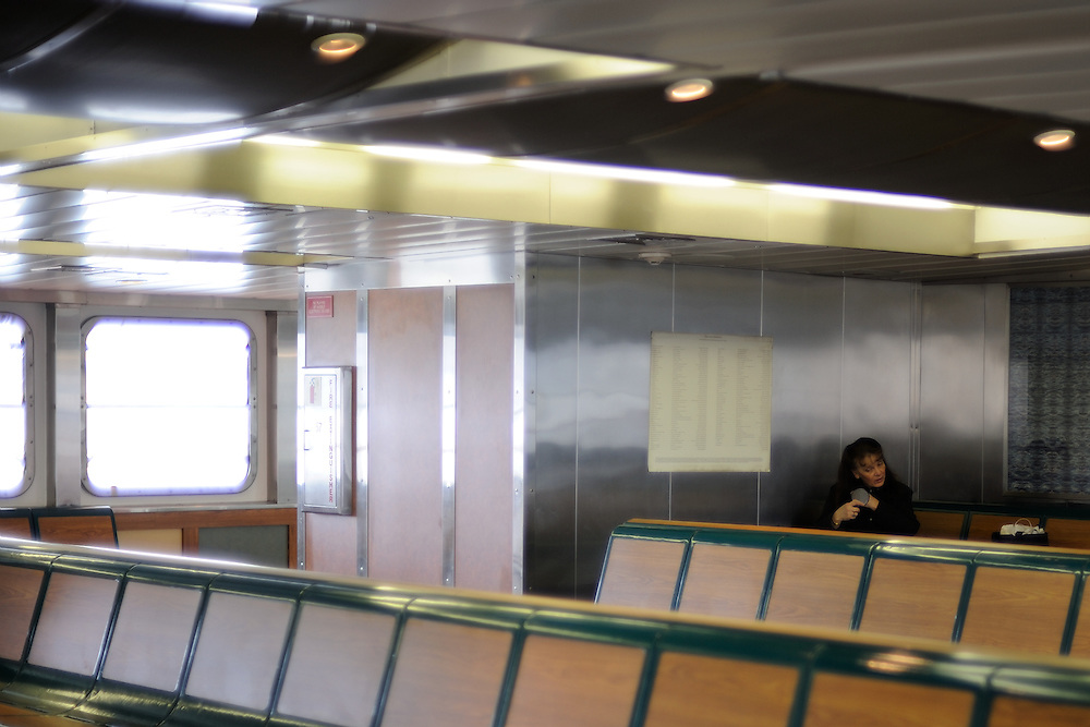 Staten Island Ferry passenger primping before her arrival into New York City.