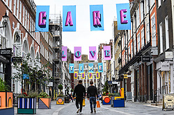 © Licensed to London News Pictures. 09/07/2020. LONDON, UK.  Artwork by award-winning British designer Alex Fowke is suspended over South Molton Street in Mayfair displaying the text HOPE, LOVE, CARE, TIME to recognise the efforts of NHS and key workers during the ongoing coronavirus pandemic and also to mark the 72nd birthday of the NHS.  Photo credit: Stephen Chung/LNP