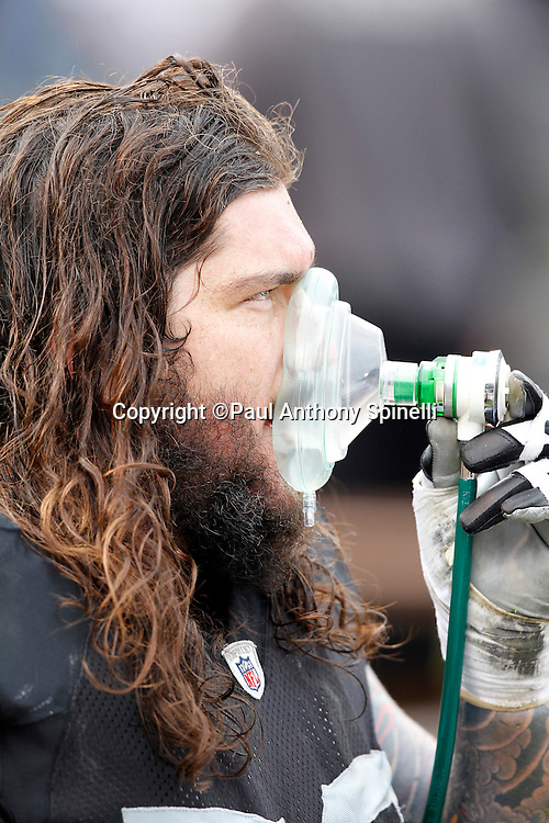 Oakland Raiders guard Robert Gallery (76) takes oxygen during the NFL week 16 football game against the Indianapolis Colts on Sunday, December 26, 2010 in Oakland, California. The Colts won the game 31-26. (©Paul Anthony Spinelli)