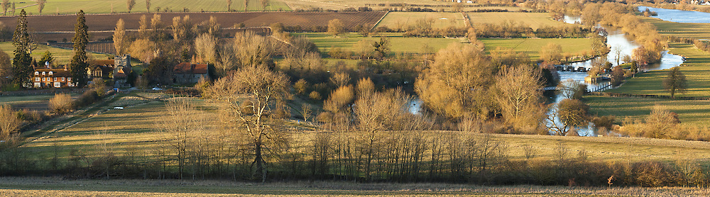 Evening light over the River Thames and Day's Lock from Wittenham Clumps near Wallingford, Oxfordshire, Uk