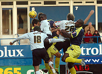 Photo: Kevin Poolman.<br />Luton Town v Derby County. Coca Cola Championship. 18/11/2006. Leon Barnett (2nd left) of Luton gets a header in on goal.