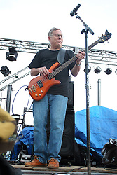 20 September 2014:  Chris Briggs.    Marc Boon and the Unknown Legends perform at the Chris Brown Benefit Concert at the Corn Crib Stadium, Normal Illinois.  The band is comprised of 8 musicians: Marc Boon - front man and lead guitar, Jeff Young - drums, Ray Wiggs- keyboards, Aaron Garcia - trumpet-percussion-vocals, Burl Torner - guitar, Russell Zehr - saxaphone-guitar-keyboards-vocals, Chris Briggs - bass-vocals-keyboard, Jerry Abner - keyboards, ,