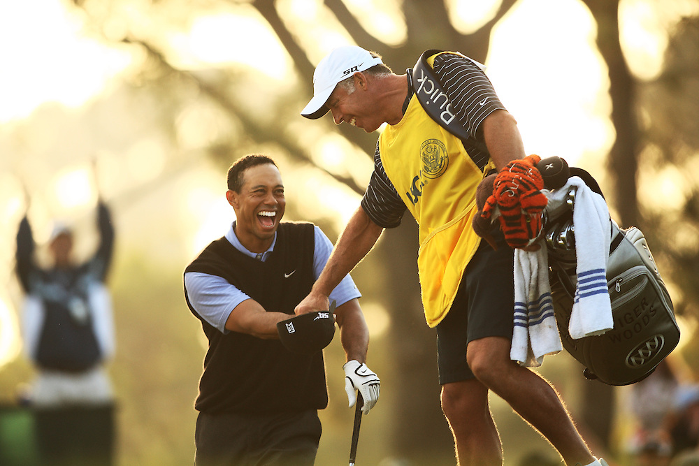 Tiger Woods is congratulated by caddie Steve Williams after holing a bunker shot during the 3rd round of the 2008 U.S. Open Championship at Torrey Pines Golf Course in La Jolla, California