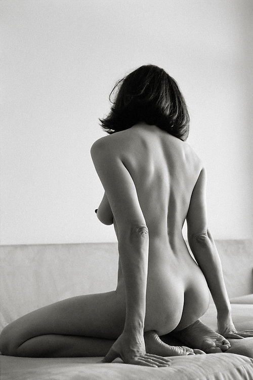 Nude Woman Kneeling on Couch