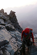 An alpinist on the Hornli ridge.<br /> <br /> &ldquo;Matterhorn 150 years Cervino&rdquo; - The year 2015 is the 150th Anniversary of the first ascent by Edward Whymper from the Swiss side (14th July) and by Jean Antoine Carrel from the Italian side on the 17th July 1865.<br /> On 17th July 2015 a friendship convention was signed by the members of Swiss, French, British and Italian climbing teams. A ceremony was held at the summit in honour of the mountain.