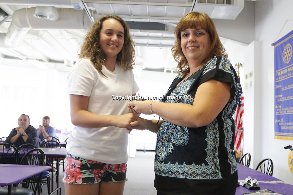 Blake Lefler accepts an award from Star News Editor Sherry Jones for the 15 Under 15 project Sunday September 14, 2014 at Jungle Rapids in Wilmington, N.C. (Jason A. Frizzelle)