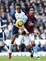 Photo: Chris Ratcliffe.<br />Tottenham Hotspur v Aston Villa. The Barclays Premiership. 21/01/2006.<br />Milan Baros (R) and Edgar Davids of Spurs clash at White Hart Lane.