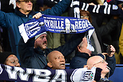 The fans hold up their scarves in tribute during the Premier League match between West Bromwich Albion and Southampton at The Hawthorns, West Bromwich, England on 3 February 2018. Picture by Dennis Goodwin.