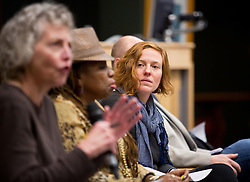 Prof. Jenny James, listens as Prof. Beth Kraig speaks while on a panel while discussing issues surrounding deaths of African-Americans by police and is sponsored by the Diversity Center, Women's Center and CCES held in the Scandinavian Center at PLU on Thursday, Dec. 4, 2014. (PLU Photo/John Froschauer)