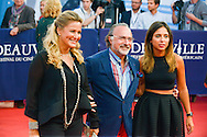 "French politician Olivier Dassault and his wife Natacha pose on the red carpet before the screening of the film ""The Man from U.N.C.L.E."" during the 41st Deauville American Film Festival on September 11, 2015 in Deauville, France"