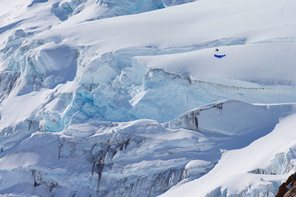 Filippo Fabbi jumps off a large glacier while filming for the Unrideables in the Tordrillo Mountains near Anchorage, Alaska on April 21th, 2014.