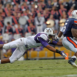 October 22, 2011; Baton Rouge, LA, USA; LSU Tigers safety Eric Reid (1) dives to tackle Auburn Tigers running back Michael Dyer (5) during the second half at Tiger Stadium. LSU defeated Auburn 45-10. Mandatory Credit: Derick E. Hingle-US PRESSWIRE / © Derick E. Hingle 2011