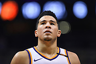 Oct 25, 2017; Phoenix, AZ, USA; Phoenix Suns guard Devin Booker (1) looks up the court in the game against the Utah Jazz at Talking Stick Resort Arena. Mandatory Credit: Jennifer Stewart-USA TODAY Sports