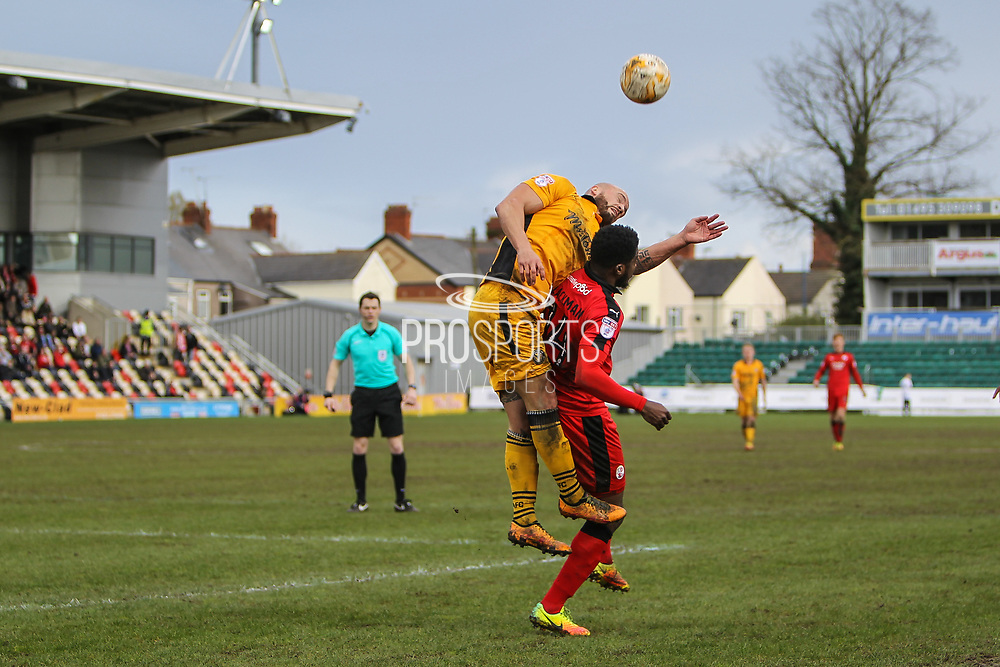 David Pipe of Newport County competes for the header during the EFL Sky Bet League 2 match between Newport County and Crawley Town at Rodney Parade, Newport, Wales on 1 April 2017. Photo by Andrew Lewis.