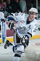 KELOWNA, CANADA - NOVEMBER 20: Logan Fisher #20 of the Victoria Royals takes a shot on net during warm up at the Kelowna Rockets on November 20, 2013 at Prospera Place in Kelowna, British Columbia, Canada.   (Photo by Marissa Baecker/Shoot the Breeze)  ***  Local Caption  ***