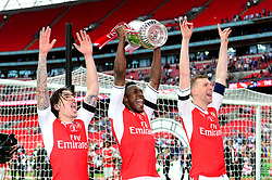 Hector Bellerin of Arsenal, Danny Welbeck and Per Mertesacker celebrate after beating Chelsea in the FA Cup Final 2017 - Mandatory by-line: Dougie Allward/JMP - 27/05/2017 - FOOTBALL - Wembley Stadium - London, England - Arsenal v Chelsea - Emirates FA Cup Final