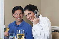 Business woman using mobile phone beside male colleague in restaurant