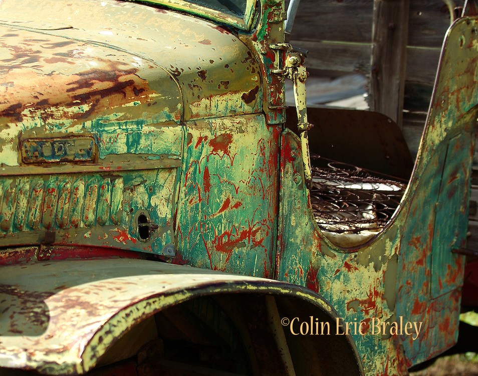 An old pickup truck near Elizabeth, New Mexico shows it's colorful past as rust and years of paint are displayed.