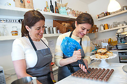 © Licensed to London News Pictures. 30/04/2015. Newtown, Wales, UK. Miriam Gonz·lez Dur·ntez - wife of Nick Clegg, Deputy Prime Minister and leader of the Liberal Democrats ñ and Jane Dodds - the new Welsh Liberal Democrat candidate for Montgomeryshire - get some from patisserie & chocolate chef Matt Smith making chocolate at a local cake shop, Patisserie 13. Photo credit: Graham M. Lawrence/LNP