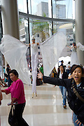 Opening weekend of Siam Paragon shopping center. Stilt walkers.