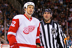 April 29, 2010; San Jose, CA, USA;  Detroit Red Wings defenseman Jonathan Ericsson (52) is escorted to the penalty box by NHL linesman Steve Miller (right) during the second period of game one of the western conference semifinals of the 2010 Stanley Cup Playoffs against the San Jose Sharks at HP Pavilion. San Jose defeated Detroit 4-3. Mandatory Credit: Jason O. Watson / US PRESSWIRE