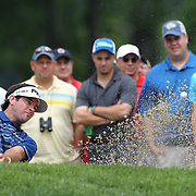 Bubba Watson chips out of the bunker on the 8th hole during the first round of theThe Barclays Golf Tournament at The Ridgewood Country Club, Paramus, New Jersey, USA. 21st August 2014. Photo Tim Clayton