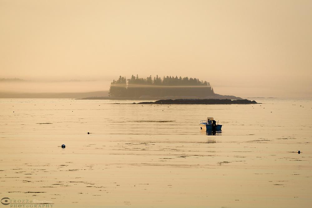 Rough coast line at sunrise, Martinsville, Maine, USA.