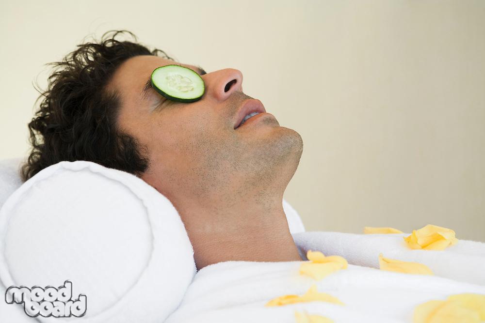 Man having facial treatment, close-up