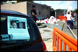 Poster's still displayed in cars near Tia Sharp's Grandma's house in New Addington, to pay respect to Tia Sharp, Who went missing a week ago. A body was found in Tia Sharp's Grandma's House on Friday August 10, 2012. Saturday August 11, 2012. Photo by Andrew Parsons/i-Images..All Rights Reserved ©Andrew Parsons/i-Images.See Instructions