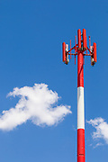 Red and white cellular antenna and pole tower