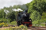 Nederland, Simpelveld, 20040523.<br /> Het miljoenenlijntje in Zuid-Limburg. Op het voormalige spoortraject tussen Schin op Geul en Simpelveld rijdt nu een stoomtrein op zon- en feestdagen.<br /> Stoomlocomotief met rook en stoom.    <br /> <br /> Netherlands, Simpelveld, 20040523.  The million line in South Limburg. On the former railway line between Epen and Simpelveld now driving a steam train on Sundays and public holidays.  Steam Locomotive with smoke and steam.