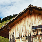 A small farm house outfitted with a solar panel in the French Alps near the town of Chatel.