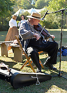 Old Bethpage, New York, U.S. 29th September 2013.  A fiddler plays for dancers at The Long Island Fair, held at Old Bethpage Village Restoration. A yearly event since 1842, and now held at a reconstructed fairground based on the original in Mineola, the Long Island Fair continues as the only county fair sanctioned by New York State for the counties of Queens, Nassau and Suffolk.