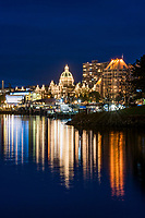 The Provincial Legislature building on the Inner Harbour of downtown Victoria, BC is decorated in white lights at night.