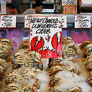 Display of fresh whole cooked Dungeness crab at the Pike Place Market, Seattle, Washington