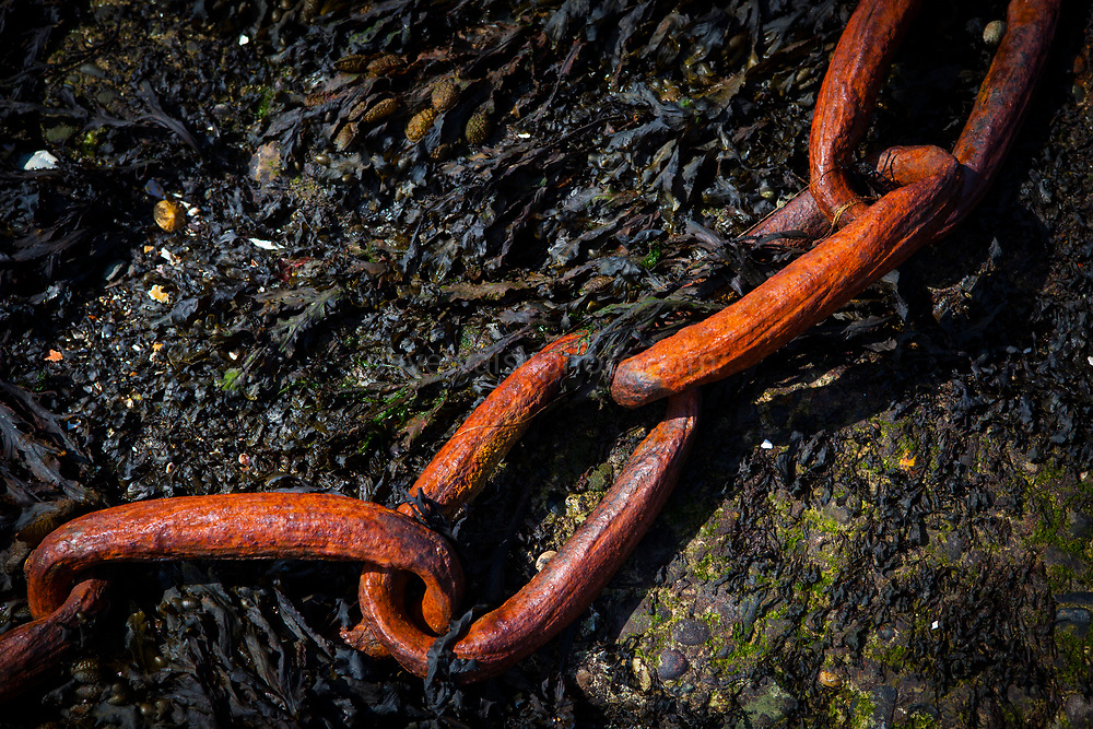 Rusting chain in Fahamore Harbour, Co, Kerry, Ireland