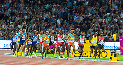 London, 2017-August-04. Arms and feet are blurred as the field completes another lap in the Men's 10,000m final at the IAAF World Championships London 2017. ©Paul Davey.
