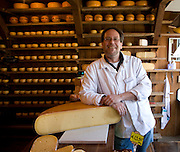 Shopkeeper in cheese shop and warehouse, Zuiderzee museum, Enkhuizen, Netherlands